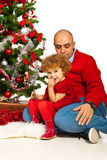 Father and dad sitting near Xmas tree Royalty Free Stock Photography