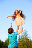 Father dad throwing and catching child girl kid daughter Stock Photos