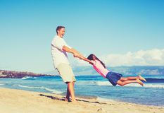 Father and Daugher Playing Outdoors Stock Image