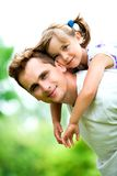 Father and Daughter. Father Giving Daughter Piggyback Ride stock image