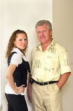 Father and daughter. Adult daughter and her father portrait in the office Stock Photography