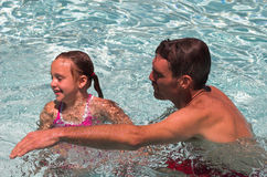 Father and Daughter. In Pool - Summer fun Royalty Free Stock Photography
