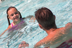 Father and Daughter. In Pool - Summer fun Royalty Free Stock Photo