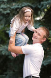Father and daughter. A happy father and daughter playing outside Royalty Free Stock Photo