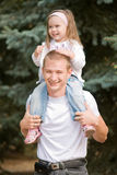 Father and daughter. A happy father and daughter playing outside Royalty Free Stock Photography