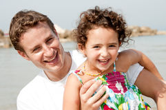 Father and daughter. Playing in the beach royalty free stock images