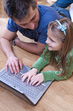 Father and daughter. On laptop together Stock Image