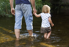 Father and daughter. Wade in water Royalty Free Stock Images