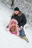 Father and daughter. In winter clothing in a winter woods Royalty Free Stock Photo