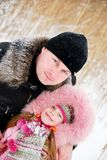 Father and daughter. In winter clothing in a winter woods Stock Photography