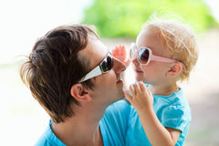 Father and daughter. Portrait of happy father and his adorable little daughter stock photos