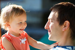 Father and daughter. Portrait of happy father and his adorable little daughter stock images