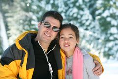 Father and daughter. Standing in a winter forest Stock Photos