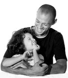 Father and daughter. Metisse father with his  daughter laughing in his arms Royalty Free Stock Photos