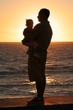 Father and Daughter. The silhouette of a father loving holding his daughter Stock Images
