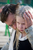 Father and daughter. Faces of father and sad weeping daughter closeup Royalty Free Stock Photo