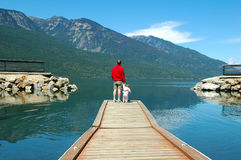 Father and daughter. Enjoying the lake view Royalty Free Stock Photos