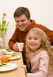 Father and daughter. Father and his daughter have a breakfast Stock Photos