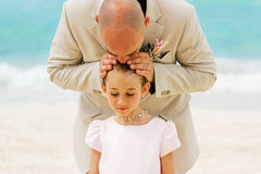 Father and daughter. Father giving a kiss on the head of his daughter, the flower girl ( Wedding day Royalty Free Stock Photo