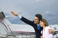 Father and daughter. Father show his daughter airplane Stock Photography