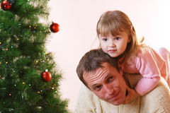 Father and daughter. Near christmas tree Royalty Free Stock Image