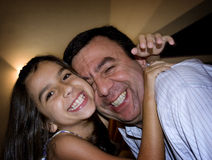 Father and Daughter. Happy girl hugs her father with love Stock Photo