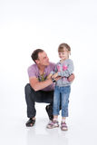 Father And Daughter. Young man with his little daughter laughing, playing royalty free stock photos