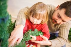 Father and daughter assembling christmas tree. Stock Photography