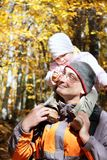 Father and daughter in autumn forest Royalty Free Stock Images