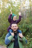 Father and daughter in an autumn forest Royalty Free Stock Images
