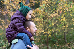 Father and daughter in an autumn forest Stock Image
