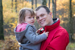 Father and daughter in autumn forest Royalty Free Stock Photo