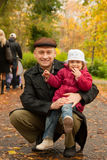 Father with  ??daughter in  autumn park Royalty Free Stock Image