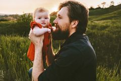 Father and daughter baby outdoor Fathers day holiday happy family. Lifestyle dad holding child walking together summer vacations parenthood concept royalty free stock photo
