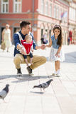 Father with a daughter and a baby. With pigeons stock photos
