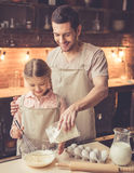 Father and daughter baking Royalty Free Stock Images