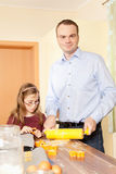 Father and daughter are baking Royalty Free Stock Photography