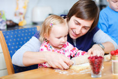 Father and daughter baking together Stock Image