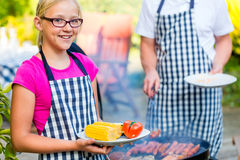 Father and daughter barbecue together Royalty Free Stock Photos