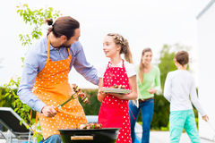 Father and daughter barbecue together Stock Photography