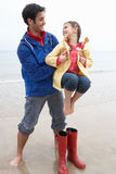 Father and daughter on beach Stock Images