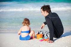 Father and daughter at beach Royalty Free Stock Photos