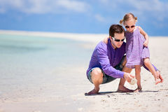 Father and daughter on beach Royalty Free Stock Photos
