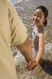 Father And Daughter On Beach Stock Image