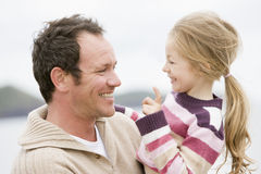 Father and daughter at beach. Smiling Royalty Free Stock Images