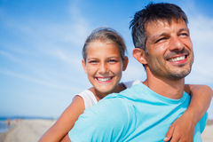 Father and daughter at the beach Royalty Free Stock Photo