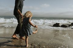 Father and daughter at a beach stock images