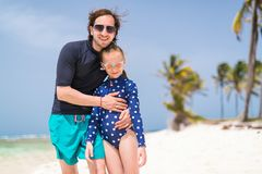 Father and daughter at beach. Father and daughter playing at beach on tropical Caribbean island royalty free stock images