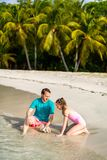 Father and daughter at beach. Father and daughter playing at beach on tropical Caribbean island stock image