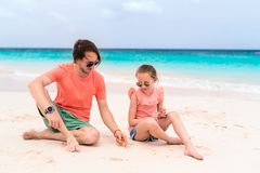Father and daughter at beach. Father and his adorable little daughter at beach royalty free stock photos